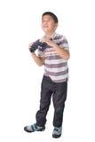 Asian boy holding binoculars,  on a white background Royalty Free Stock Image