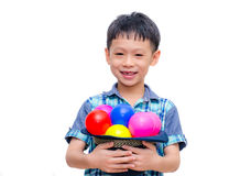 Asian boy holding colorful balls Royalty Free Stock Photos