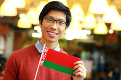 Asian boy holding flag of Belarus Stock Photo