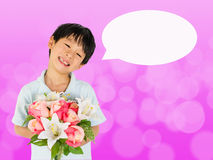 Asian boy holding flower bouquet Royalty Free Stock Images