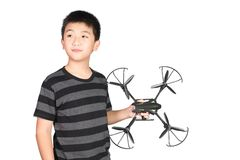 Asian boy holding hexacopter drone or quadrocopter toy in hand,. Studio shot isolated on white background royalty free stock image