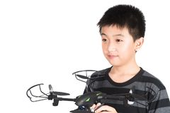 Asian boy holding hexacopter drone or quadrocopter toy in hand,. Studio shot isolated on white background stock image