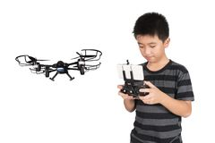 Asian boy holding hexacopter drone and radio remote control hand. Asian boy holding hexacopter drone and radio remote control controlling handset for helicopter royalty free stock images
