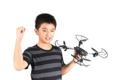 Asian boy holding hexacopter drone and radio remote control hand. Asian boy holding hexacopter drone and radio remote control controlling handset for helicopter royalty free stock photography