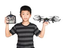 Asian boy holding hexacopter drone and radio remote control hand. Asian boy holding hexacopter drone and radio remote control controlling handset for helicopter stock photography