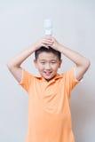 Asian boy holding a lamp, energy saving lamp, Stock Images