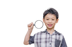 Asian boy holding magnifier glass Stock Images