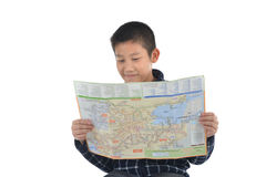 Asian boy holding map on white background.  Travel concept. Stock Images
