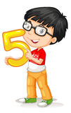 Asian boy holding number five Royalty Free Stock Image
