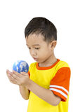 Asian boy holding our planet earth in his hand. Stock Photos
