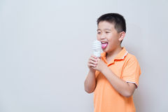 Asian boy joking gesture licking fake ice cream made with energy Royalty Free Stock Image