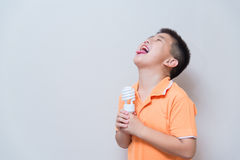 Asian boy joking gesture licking fake ice cream made with energy Stock Photo