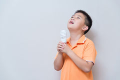 Asian boy joking gesture licking fake ice cream made with energy Royalty Free Stock Photos