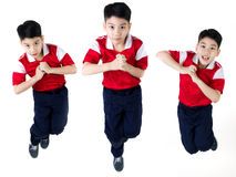 Asian boy  jumping over white background Royalty Free Stock Images