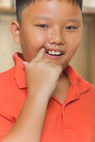 Asian boy just losing his milk tooth Stock Photos