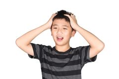 Asian boy kid holding his head frowning with screaming. pulling Stock Photography