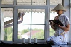 Asian boy in kimono reading an old book Royalty Free Stock Photo