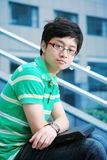 Asian boy with laptop Stock Images