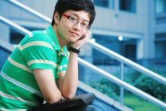 Asian boy with laptop Royalty Free Stock Photos