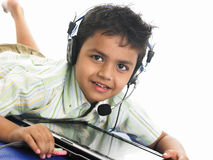 Asian boy with laptop and headphones Royalty Free Stock Images