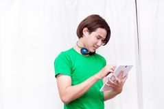 Asian boy laughing,listening music using tablets and headphone stock photos