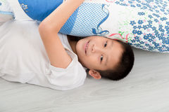 Asian boy laying on floor. Royalty Free Stock Images