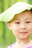 Asian boy with leaf cap Stock Image
