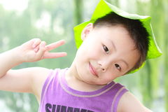 Asian boy with leaf cap Royalty Free Stock Photos