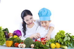 Asian boy learn to cut - isolated Royalty Free Stock Photos