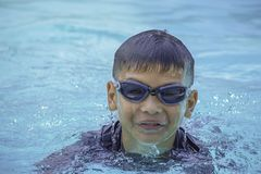 Asian boy learned to swim in the pool royalty free stock image