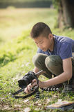 Asian boy learning to taking photo from camera Royalty Free Stock Photo