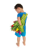 Asian boy with light handicap. And a colorful bouquet tulips Royalty Free Stock Images