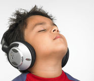 Asian boy listenig  to music Royalty Free Stock Photography