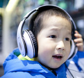 Asian boy listening the music Stock Photography
