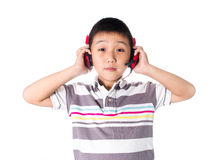 Asian boy listening music with headphones, isolated on white background Stock Photography