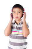 Asian boy listening music with headphones, isolated on white background Royalty Free Stock Photo