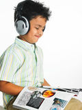 Asian boy listening to music. And reading a magazin Stock Photos