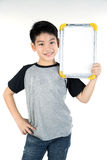 Asian boy is little smile with blank white board and looking cam Stock Photography