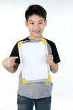 Asian boy is little smile with blank white board and looking cam Royalty Free Stock Image