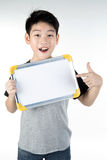 Asian boy is little smile with blank white board and looking cam Royalty Free Stock Photography