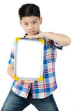 Asian boy is little smile with blank white board and looking cam Stock Images
