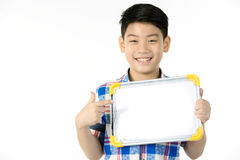 Asian boy is little smile with blank white board and looking cam Stock Image