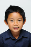 Asian Boy looking at camera. And smiling stock image