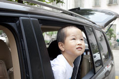 Asian boy looking out of the car Stock Image
