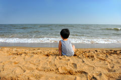 Asian boy looking at the sea Royalty Free Stock Images