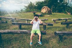 Asian boy looking through a telescope. Child relaxing holiday. V Royalty Free Stock Images