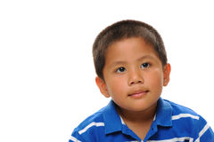 Asian Boy looks happy. Asian boy wearing blue shirt looking cute and happy Stock Photos