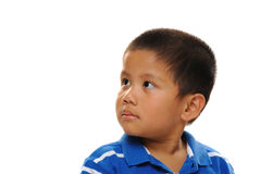 Asian Boy looks happy. Asian boy wearing blue shirt looking cute and happy Royalty Free Stock Image
