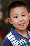 Asian boy is making face Stock Image