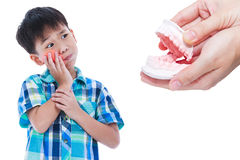 Asian boy with oral problem. Hand human holding dental mold. Iso Royalty Free Stock Image